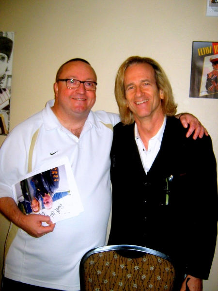Elton John''s keyboardist, Kim Bullard (right) with fan Andy Thorpe of London, England.