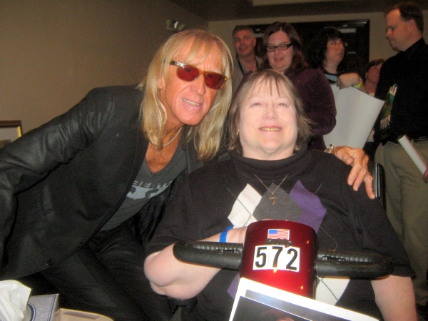 Elton John fan Jan Kemp of Chicago meets Davey Johnstone of the Elton John Band.