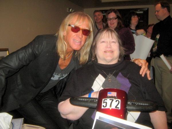 Elton John fan Jan Kemp of Chicago meets Davey Johnstone of the Elton John Band.