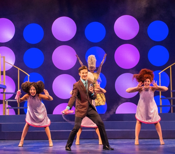 ABT favorite Ryan Michael Crimmins (center) is Corny Collins in Arizona Broadway Theatre''s production of Hairspray. (From left: Chica Loya, Ryan Michael Crimmins (bottom center), Lauren Morgan (top center), Hannah Elyse Bently)