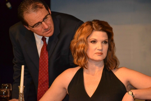 Gerardo (Kevin Daugherty) tries to explain to Paulina (Malinda L. Beckham) why he is late for supper.