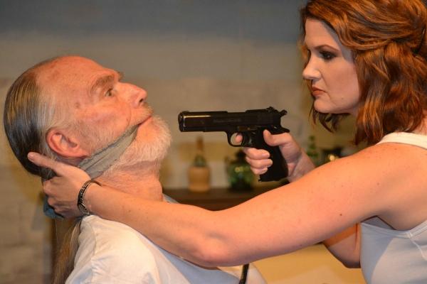 Paulina (Malinda L. Beckham) interrogates the captive Roberto (John Stevens). Photo
