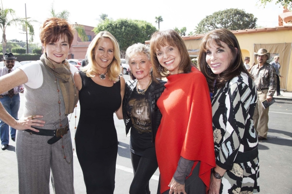 Carolyn Hennesy, Erin Murphy, Tippi Hedren and Kate Linder gather as they take turns signing Margaret Chgo''s bike for charity