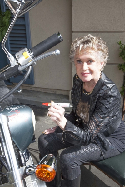 Tippi Hedren (The Birds & Marnie) signs bike