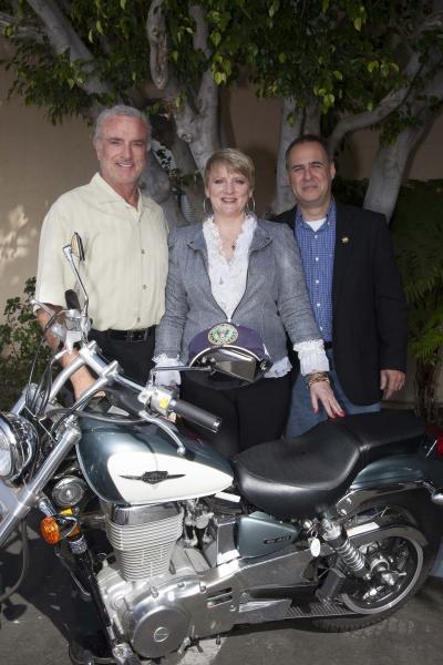 Kevin Dobson (Knotts Landing), Alison Arngrim and Greir Weeks pose with bike before signing begins