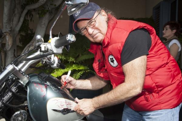 Director, Joel Zwick, signs bike