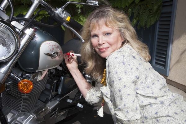 Marta Kristen (Lost in Space) signs bike  Photo