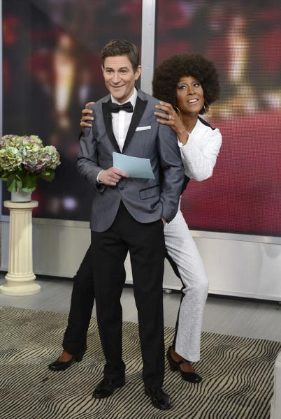 GOOD MORNING AMERICA - Coverage of GOOD MORNING AMERICA''s Halloween Show featuring the ''Buzzy Awards,'' 10/31/13, airing on the ABC Television Network.   (ABC/Ida Mae Astute)  DAN HARRIS (as Ryan Seacrest) welcomes guest ROBIN ROBERTS (as Oprah Winfrey