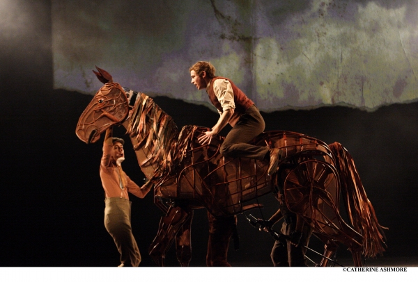 JACK HOLDEN as Albert in War Horse, with TOBY OLIÈ, THOMAS WILTON and MICHAEL BRETT as Joey (premiered at the NT in 2007)