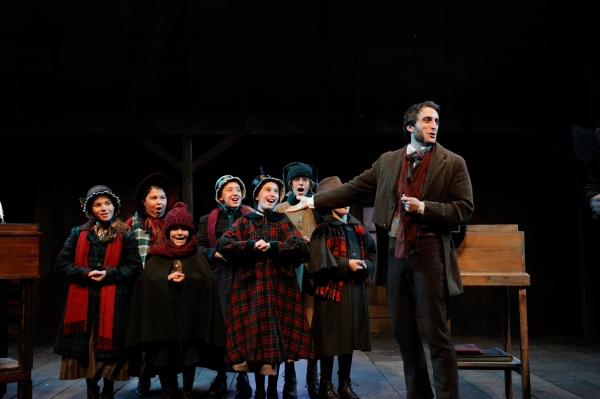 The children''s cast with Charlie Thurston as Bob Cratchit