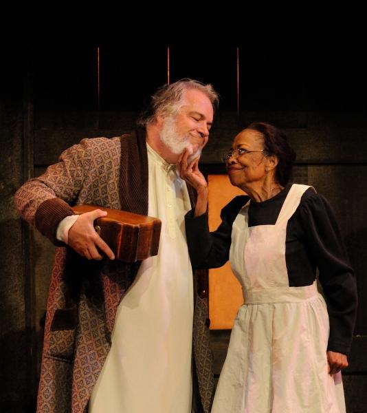 Fred Sullivan, Jr. as Scrooge with Barbara Meek