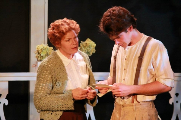 Eliza (Alison Blanchard) conveys the bad news to Eugene (Grant Tambellini)