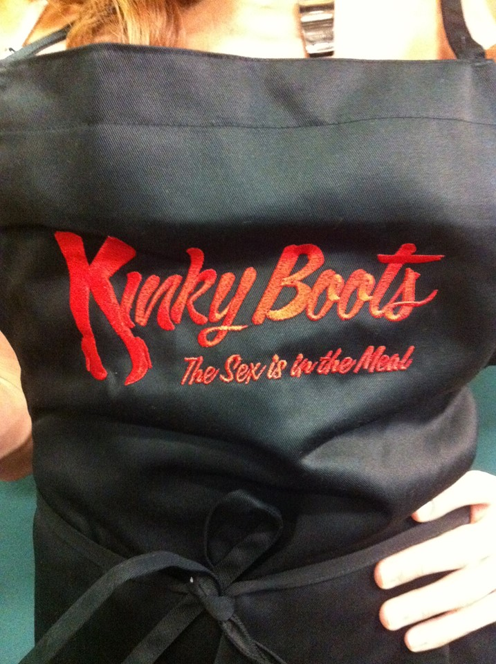 KINKY BOOTS BC/EFA Aprons Now Available, Donations Go To Charity