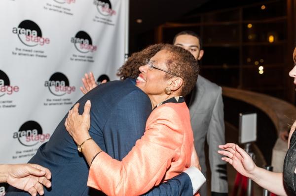 Leo Manzari embraces Congresswoman Eleanor Holmes Norton