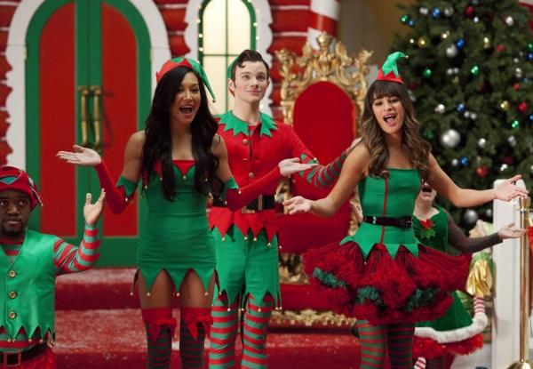 Kurt (Chris Colfer), Santana (Naya Rivera) and Rachel (Lea Michele) work as Santa''s  Photo