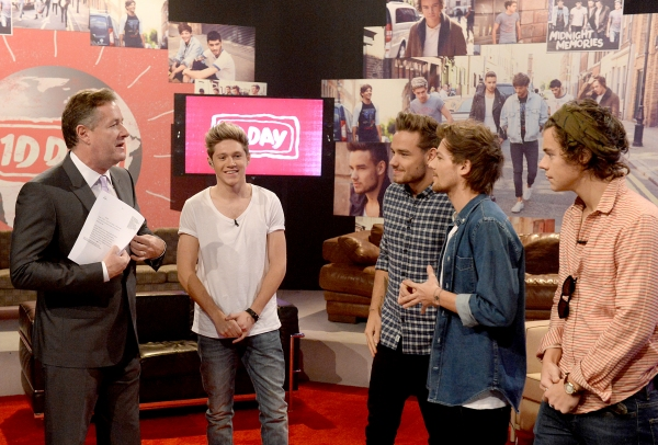 PLAYA VISTA, CA - NOVEMBER 23:  (L-R) Piers Morgan, Niall Horan, Liam Payne, Louis Tomlinson, and Harry Styles on set during One Direction celebrates 1D Day at YouTube Space LA, a 7-hour livestream event broadcast exclusively on YouTube and Google+. Featu