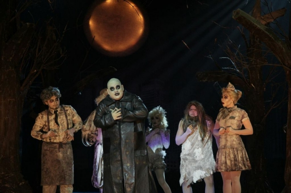 (Center) Jamie Wilson as Uncle Fester