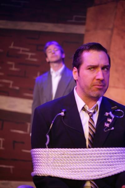 Stephen Woosley as Mr. Rondo (background), Erik Sternberger as Agent Stern (foreground)