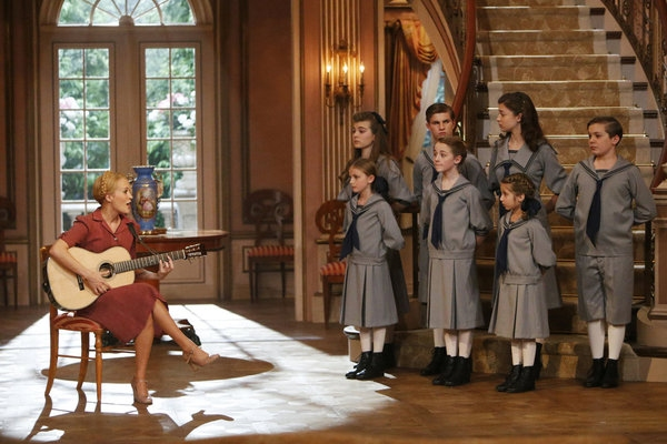 THE SOUND OF MUSIC LIVE! -- Pictured: Carrie Underwood as Maria with (back, l-r) Ella Watts-Gorman as Louisa, Michael Nigro as Friedrich, Ariane Rinehart as Liesl, Joe West as Kurt; (front, l-r) Grace Rundhaug as Marta, Sophia Ann Caruso as Brigitta, Peyt
