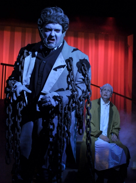 The ghost of Jacob Marley (Eddie Curry), left, warns Ebenezer Scrooge (Jeff Stockberger) that three more spirits will visit him through the night