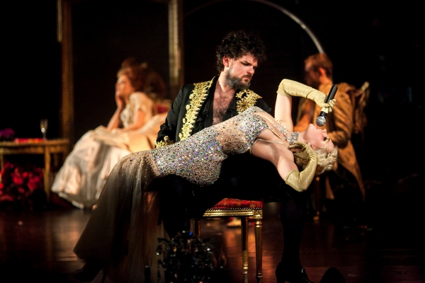 Katrina Cunningham (singing) and Jeff Takacs as Monsieur Drosselmeyer (seated) in Nutcracker Rouge. Photographer: Phillip Van Nostrand