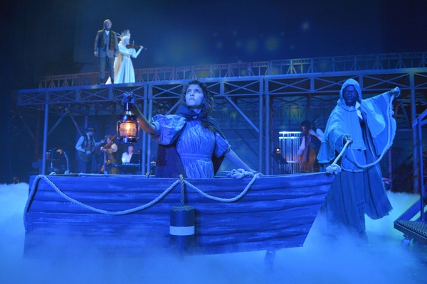 Gerda (Eryn Murman) is fording the River, played by (Rhett George), in search of Kai (Tim Homsley), who looks on next to the Snow Queen (Jane Pfitsch) in San Jose Rep's world premiere musical adaptation of The Snow Queen.