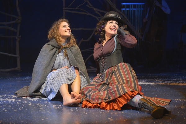 Gerda (Eryn Murman)shares a laugh with the Witch (Lee Ann Payne) in San Jose Rep's world premiere musical adaptation of The Snow Queen.