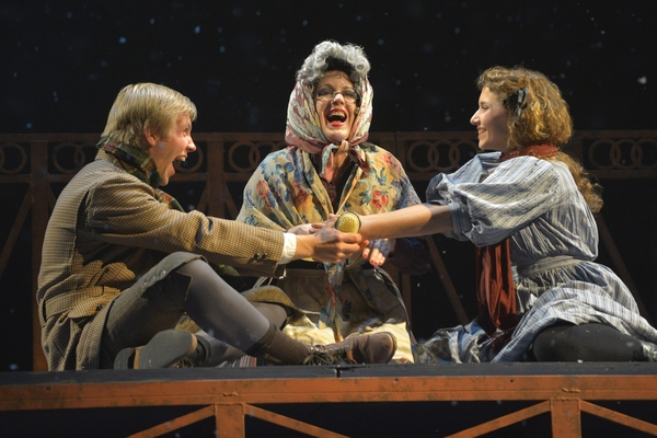 Kai (Tim Homsley),Grandmother (Lee Ann Payne) and Gerda (Eryn Murman) play games in San Jose Rep's world premiere musical adaptation of The Snow Queen.
