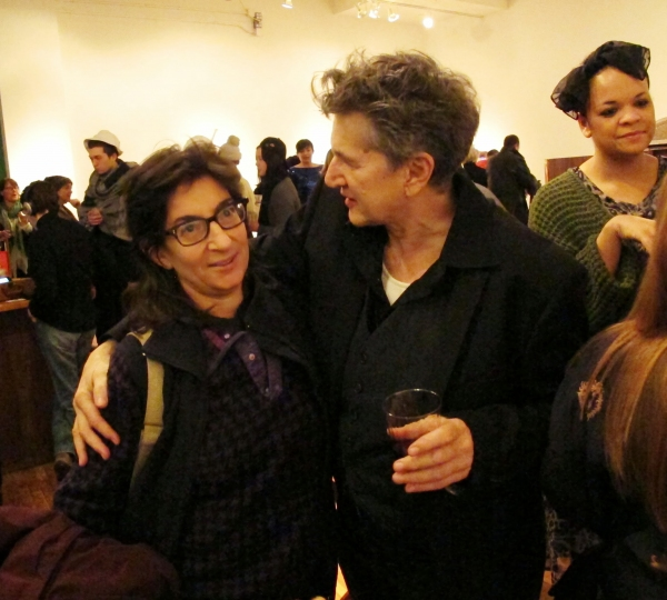 Theater critic and dramaturg Alissa Solomon is greeted by Peggy Shaw.