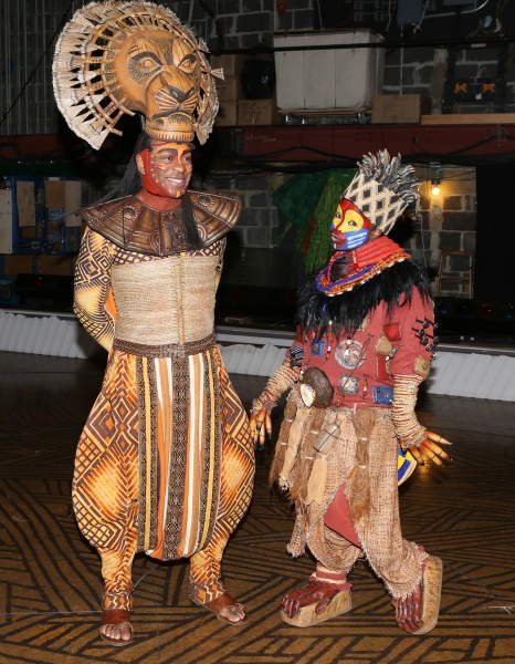 Alton Fitzgerald White as ''Mufasa'' and Mukelisiwe Goba as ''Rafiki'' pose backstage after a performance of ''The Lion King'' at the Minskoff Theatre on January 12, 20114 in New York City.