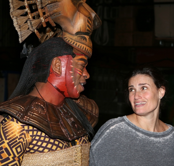 Alton Fitzgerald White as ''Mufasa'', Idina Menzel pose backstage after a performance of ''The Lion King'' at the Minskoff Theatre on January 12, 20114 in New York City.