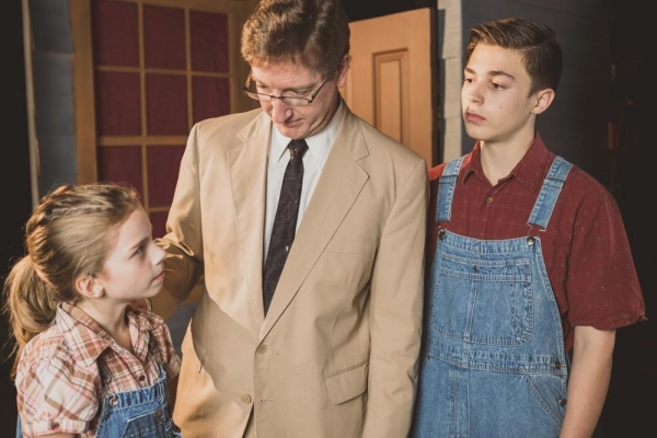 Liberty Evans-Agnew as Scout, Jim Rogers as Atticus Finch, Gunnar Johnson as Jem