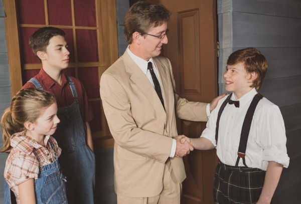 Liberty Evans-Agnew as Scout, Gunnar Johnson as Jem, Jim Rogers as Atticus Finch, Austin Kuetgens-Brooks as Dill