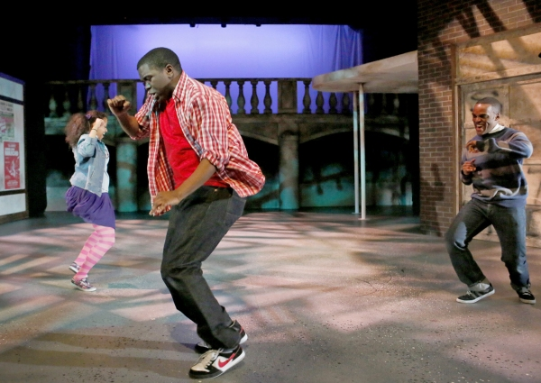 (foreground) Jonathan Butler-Duplessis plays Steven, president of the Flint Future Detectives, grooving out here with (background, from left) fellow junior detectives Richelle (Ashley Elizabeth Honore) and Russell (Travis Turner)