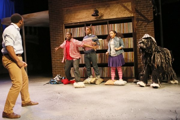 Elmwood (Bear Bellinger, back to camera) catches his son Steven (Jonathan Butler-Duplessis) with Steven's fellow Flint Future Detectives Russell (Travis Turner), Richelle (Ashley Elizabeth Honore) and Zoopy the dog (puppeteer Sam Deutsch) searching