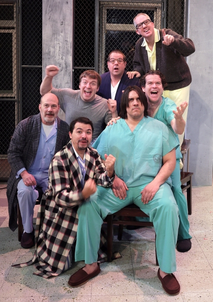 (From lower left, plaid robe) Jason Rainwater as Anthony Martini, Russ Harlan as Frank Scanlon, Charlie Reese as Billy Bibbit, Jason Crowley as Charles Atkins Cheswick III, Jeff Rohrick as Dale Harding, Tim Wisgerhof as Randle Patrick McMurphy, and Josh V