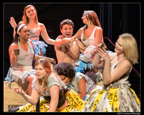 Emilio Vieira (Macheath) cavorting with ''the girls'' - inmates in the Lincoln Fields Photo