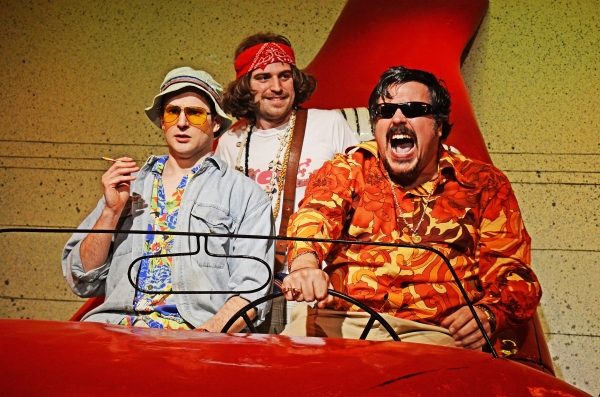 Ed Hughes (Raoul Duke), Tom Moores (Ensemble) and Rob Crouch (Dr Gonzo) in Fear and Loathing in Las Vegas. Photo by Nobby Clarke.
