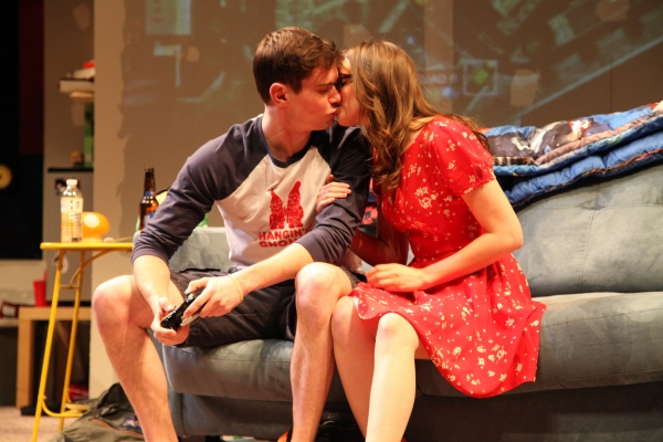 Zander (JJ Phillips) and Jeannie (Carolyn Braver) steal a kiss