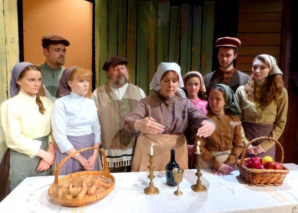 Tevye''s family begins Sabbath with two special visitors.  (from left: Carly Linehan, Spencer Johnson, Jessica D. Stone, Bradley Miller, Susie McCarthy, Gabrielle Olivas, Fiona Okida, Nathan Fleischer, Kelsey Nisbett)