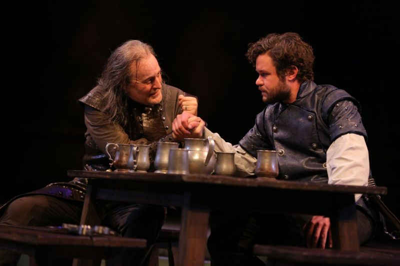 Stephen Yoakam and John Catron as Iago and Cassio in Guthrie Theater's OTHELLO. By Joan Marcus