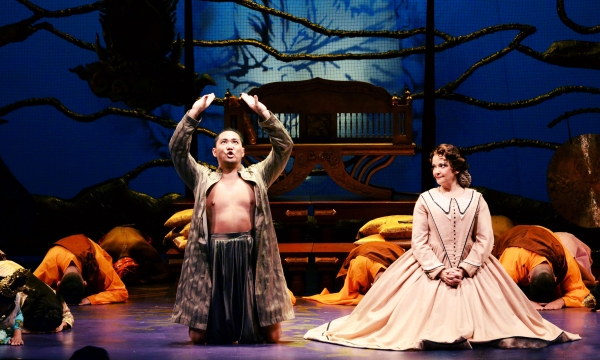 Wayne Hu (as the King of Siam), left, and Michele Ragusa (as British schoolteacher Anna Leonowens), right