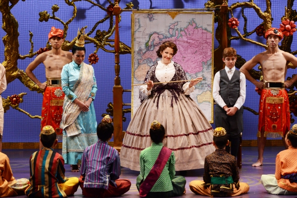 Michele Ragusa (as British schoolteacher Anna Leonowens), center, teaches her students a lesson in geography