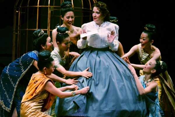 Michele Ragusa (as British schoolteacher Anna Leonowens), center, is surprised to learn of cultural differences in clothing