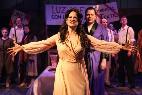 Emily Goldberg as Eva Perón and John Gurdian as Perón