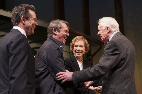 Playwright Lawrence Wright and cast member Richard Thomas (as Jimmy Carter) are greeted by Rosalynn Carter and President Jimmy Carter following the opening night curtain call