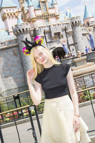 Elle Fanning poses at Sleeping Beauty Castle at Disneyland Photo