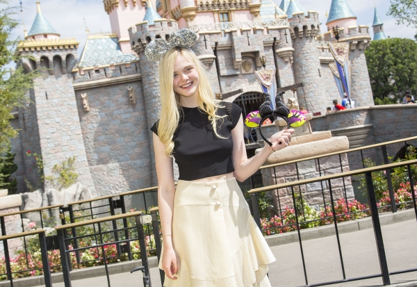 Elle Fanning poses at Sleeping Beauty Castle at Disneyland