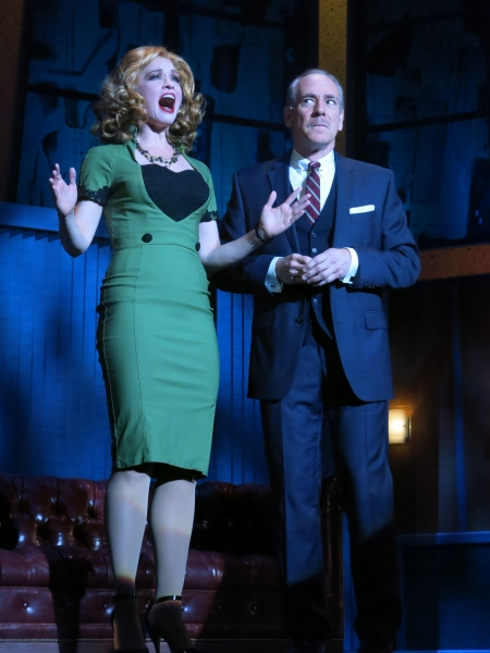 Amy Bodnar as Hedy LaRue and Mark Jacoby as J.B. Biggley