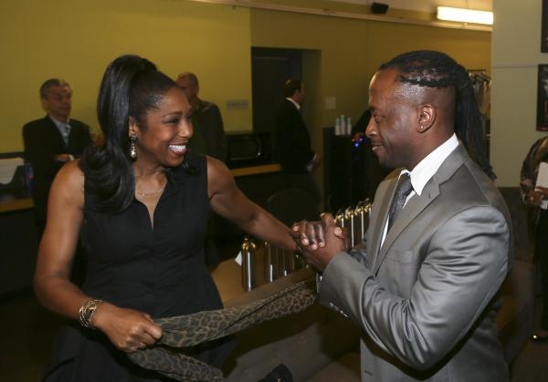 Dawnn Lewis congratulates Music Director Kenny J. Seymour backstage